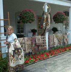 Edyta of Laundry Basket Quilts and some of her amazing quilts!  I'm pretty sure this is Lolly's porch.