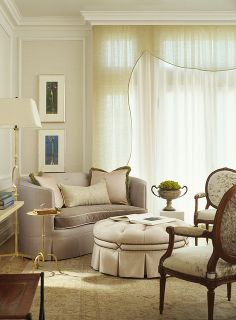 In this living room, above, the inner wall molding is painted Spanish White(a yellow white), the outer wall molding is White Dove, the molding and crown trim is White Opulence(very similar to White Dove), and the ceiling is Sand Dollar(a pinkish white), all by Benjamin Moore
