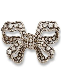 AN ANTIQUE DIAMOND BOW BROOCH, BY MUSY, TURIN, CIRCA 1860. Of openwork ribbon design, each loop enclosing a graduated line of old-cut diamond collets to the central tie, mounted in silver and gold, 6.0 cm. wide. This was one of the several wedding gifts to Queen Maria José from King Victor Emmanuel III and Queen Elena. Maria José wore this brooch on her sash to the wedding of King Constantine of Greece and Princess Anna Maria of Denmark in 1964.