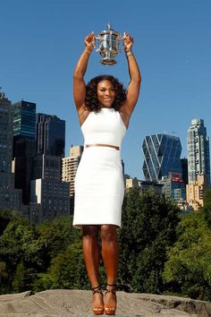 2012 US Open Women's Singles Champion Serena Williams poses with the trophy in Central Park