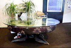 Fabricant de table basse design sur mesure , un mélange verre et métal pour une création originale .