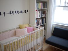 This crib bumper/pillows is so cute and simple... I would just need to switch it to boy colors.