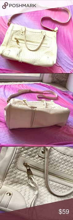 """Steve Madden Cream Cross body Shoulder Handbag Steve Madden Cream Bone Lattice Cross body Shoulder Handbag. Great gently loved condition. - Minor scuffing and wear to interior. Detachable cross body and shoulder straps and lost of pockets and gold fixtures. Perfect tote for books or just a large purse. 11""""X14""""X7"""". Exterior 100% PVC, Interior 100% cotton. Steve Madden Bags Crossbody Bags"""