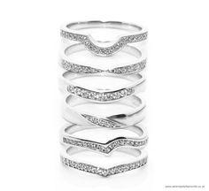 The Horseshoe shaped wedding ring. The Bow-tie shaped wedding ring. The Curve shaped wedding ring. The Twist diamond wedding ring, the Sweep ring, and finally the Horseshoe shaped wedding ring.