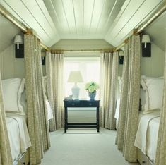 attic guest room with 4 sleeper car style draped beds