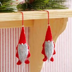For centuries, gnomes have spread their magic and mischief from Scandinavia to Germany to the Czech Republic and beyond. This year, invite felt ornament versions of the little imps into your home and heart. Theses identical fellows are hand-sewn from red felt and topped with needle-felted roving for beards and beads for noses. /