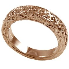 Gorgeous wedding rings. I love intricate details like these more than big diamonds. I care more for the details. :)