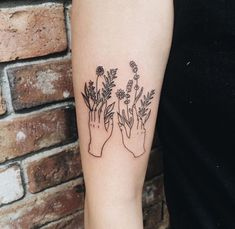 Hand with flowers line minimalist tattoo