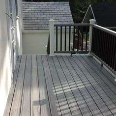 Second story deck done in Trex Transcend Island Mist using hidden clips with Trex Transcend White Posts with Gravel Path Railing and Black Balusters. Fascia, Stringers, Risers and Posts wrapped in Azek PVC Trim. Deck was in Port Washington, NY. Pergola Swing, Diy Pergola, Pergola Kits, Pergola Ideas, Porch Ideas, Pallet Pergola, Iron Pergola, Pergola Decorations, Black Pergola
