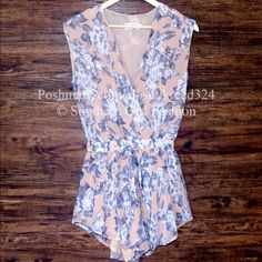 """❗️LOWEST PRICE❗️FLORAL ROMPER Printed V Jumpsuit Size Small.  New with tags.  $95 Retail + Tax.   Printed floral romper with elastic drawstring waist and crossover v neck.  Lined body. Unlined Sleeves.  Measurements for Small: Length: 32"""" Bust: 34"""" Waist: 25"""" Hips: 37"""" Inseam: 2""""  ❗️ Please - no trades, PP, holds, or Modeling.    Bundle 2+ items for a 20% discount!    Stop by my closet for even more items from this brand!  ✔️ Items are priced to sell, however reasonable offers will be…"""