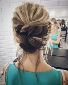 Beautiful low updo with braid wedding hairstyle | fabmood.com #hairstyle #chignon #weddinghairstyle #updoideas #bridehair #braidupdo #weddinghairstyles