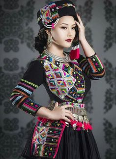 Super gorgeous hmong outfit, worn by Hmong music artist Yasmi. Made from Laotian cloth.