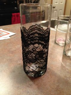 Ruffled�   See ads - Black Lace Vases - set of 8 - Decor ....we could do this with white lace and add candles to accentuate the center pieces