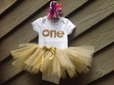 This listing is for a onesie and tutu. The tutu is glittered with gold, silver, pink, purple or red to match the onesie. Your little one will