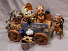 Polymer Clay Yorkie Antique Wagon by Laurie Valko, via Flickr