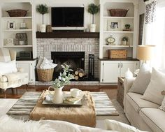 cheerful IKEA hacks that you'll want to recreate This LACK coffee table is almost unrecognizable with a whitewashed wood surface.This LACK coffee table is almost unrecognizable with a whitewashed wood surface. Built In Around Fireplace, Fireplace Built Ins, Fireplace With Bookshelves, Tv Over Fireplace, Living Room Decor Fireplace, Home Fireplace, Fireplace Ideas, Farmhouse Fireplace, Living Room Ideas With Fireplace And Tv