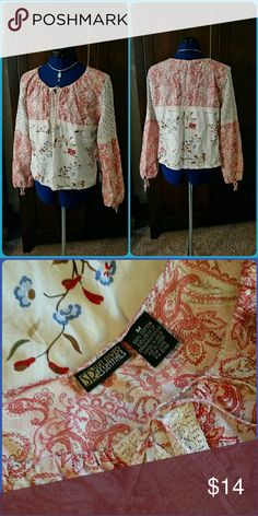 Cotton Peasant Top Floral print cotton peasant top. Drawstring tie sleeve cuffs and center front drawstring neck tie with lace trim. Cream, pinkish red. And a bit of blue. Great used condition. Sun River Essentials Tops Blouses