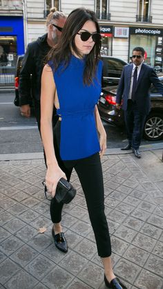 Kendall Jenner wears a blue Solace London tunic, black cigarette pants and loafers