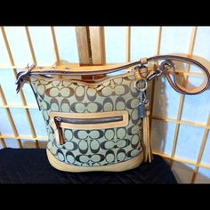 GREAT COACH BAG. This is a great bag. It has one small ink line as seen on last picture. I cleaned and moisturized the leather. It still is a great bag you can see the pictures to tell how great it is. Coach Bags