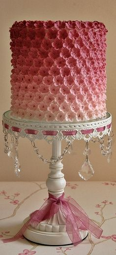 Ombre Pink Flowers cake with sugar paste flowers on a beautiful stand.    ᘡղbᘠ