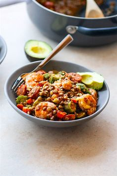 One Pot Shrimp Jambalaya Lentil Bowls! A grain free, healthy southern food dinner of classic Jambalaya and shrimp gumbo. Get the healthy dinner recipe here!
