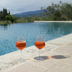 Aperol spritz aperitif on the swimming pool edge - a total relax and stress free holiday in Tuscany