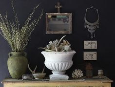 Love the idea of bringing vanity pieces onto the wall, like the statement necklace.
