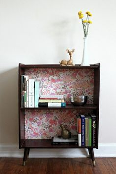Lovely bookshelf with custom back. Could easily be done by wallpaper-ing the back panel.