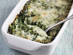 Creamed Spinach Gratin - Ezra Pound Cake (Christmas Thanksgiving Father's Day Dinner Wheat Dairy Vegetables Gluten Animal products Appetizer / sides Thanksgiving dinner Casseroles forever Salt Nutmeg Yellow onions Black pepper Heavy cream Flour Frozen spinach Milk Butter Gruyere cheese Parmesan cheese)