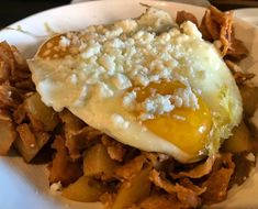 Chilaquiles at with fried eggs, tortilla strips, yukon potatoes, ranchero sauce and cotija // Brunch Chicago, Yukon Potatoes, Fried Eggs, Brunch Ideas, Cheesesteak, Magazine, Ethnic Recipes, Food, Meal