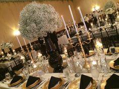 roaring 20s, centerpiece, babes breath, black, white, gold, warm, candles, candelabra, gold candelabra, tablescape, table decor, wedding