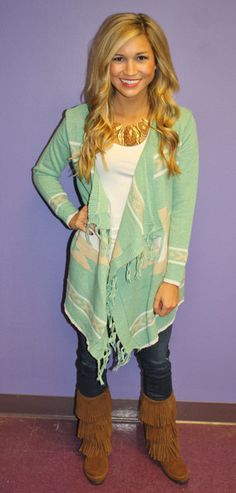 Outfit with mint cardigan, white tee, mint jeans, cognac boots