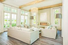 Pizitz Home and Cottage - living rooms - rustic wood beams, crystal chandelier, natural linen sofa, slipcovered sofa, natural linen slipcove...