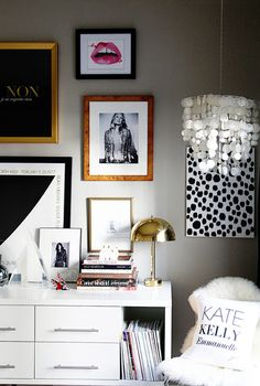 Styling | gallery wall, white console, brass mid century lamp, chair with lambs wool and personalized pillow
