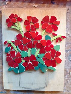 Felicity Ball mosaics: A step by step guide to making a red geraniums mosaic.