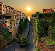 Sorrento, Italy-this looks fake. But love sorrento!! One of the prettiest sunsets I've ever seen:)