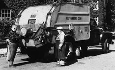 Vintage garbage truck and sanitation workers.  2009 CCJ Notes
