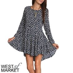 High-Low Floral Dress We LOVE this ultra-flattering high-low dress. Sprinkled with white flowers, this navy dress is fitted until right above the natural waist, where it flares into a high-low skirt. A zipper down the back gives it the perfect edge. West Market SF Dresses High Low