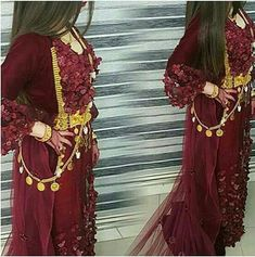 Beautiful red Kurdish Dress with a golden ‎belt and Jewelry.