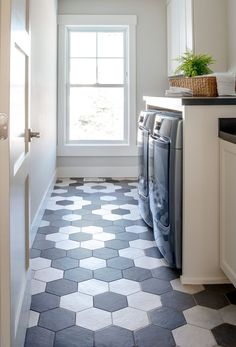 black and white decorating - laundry room with black and white pattern tile floors Decor, Black And White Tiles, Black And White Flooring, Hexagon Tile Floor, Patterned Floor Tiles, Black Tile Bathrooms, Flooring, White Tile Floor, White Laundry Rooms
