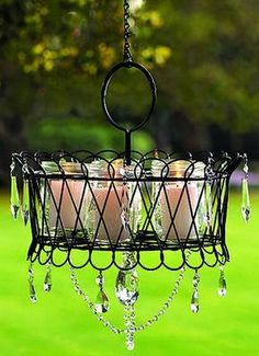 This charming outdoor chandelier is made from a wire basket you can pick up cheap at your local thrift shop.  Dress it up anyway you like. Insert candles. Voila !