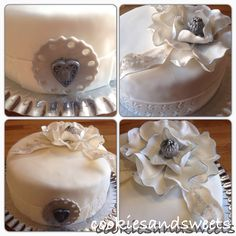 White cake, sugar flower topper and other fondant decorations