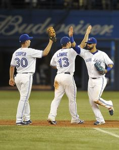 June 15, 2012: Toronto Blue Jays Team Photos - ESPN. David Cooper, Brett Lawrie, and Jose Bautista celebrating their win over the Phillies during interleague play at Rogers Centre.