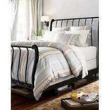 pottery barn cast iron sleigh bed - good alternative to a bed skirt on my sleigh bed