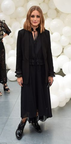 Gothic glamour: Olivia Palermo rocked a chic black pleated maxidress...