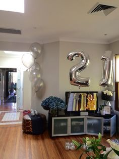 "Silver and classy was the theme for this 21st - with huge 16"" balloons in the floor arrangements - a twist from our regular 11"" balloons. All 5 x 16"" balloons measured 2m total height"