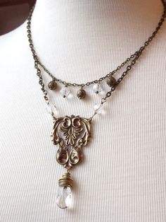 Vintage Victorian Necklace Ornate Antique Brass Stamping Crystal Beads Double Chain Vintage. $48.00, via Etsy.