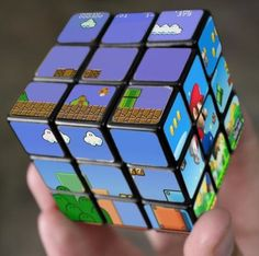 Whoever said video games rot the mind clearly never tried their hand at the Super Mario Bros Rubik's Cube. Each side of this Nintendo themed Rubik's Cube . Mario Bros., Mario Party, Mario Toys, Deco Gamer, Retro Game, Nintendo, Cube Puzzle, Mario Brothers, Geek Out