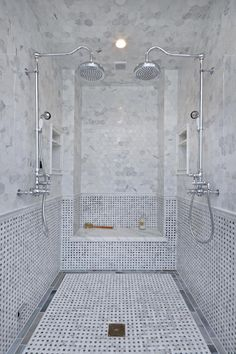 The floor to ceiling tile gives the space a luxurious look and the basket weave tile design adds an impressive detail to this spacious shower.