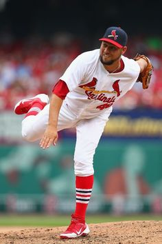 The Closer Edward Mujica pitches against the San Diego Padres... Cards won the game 3-2.  7-21-13